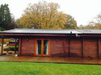 4kWp in-roof Amerisolar 250w array on a log cabin annex