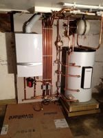 Boiler and water cylinder installed in a basement