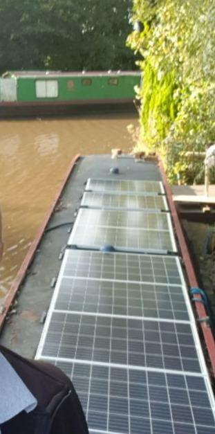 Solar panels and battery installed on a Barge Boat
