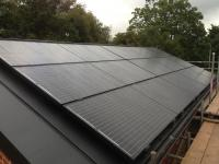 All Black array over Zinc roof, Acle.