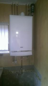 Boiler and central heating installation