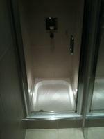 Narrow shower enclosure