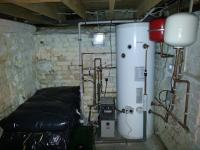 New system boiler, unvented hot water cylinder, cold water storage tank and booster pump